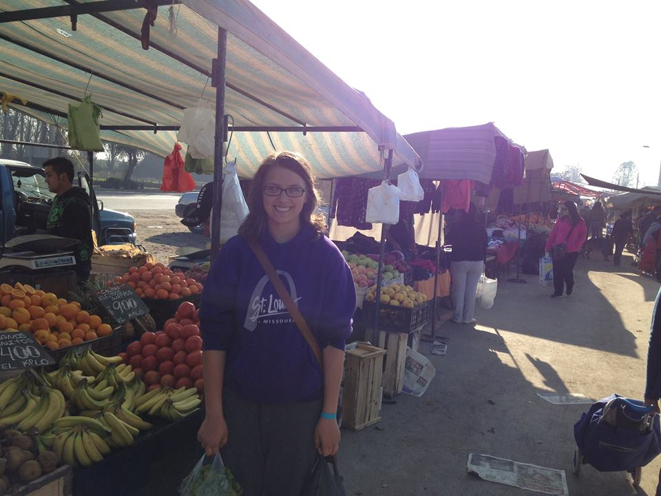 Intern Jordan Halbrooks learning how to buy fruit and veggies at the street fare in Santiago, Chile