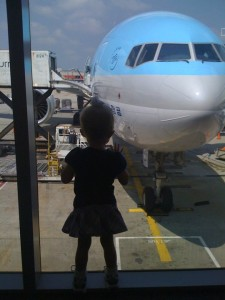 My daughter checking out the airplane before boarding our flight to China!
